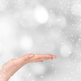 Woman hand on Christmas background Stock Images