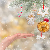 Woman hand on Christmas background Stock Image