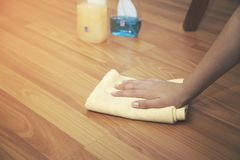 Woman hand cleaning an hardwood floor with a microfiber cloth.  royalty free stock photography