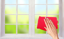 Woman hand cleaning the window Royalty Free Stock Photos