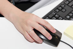 Woman hand click the mouse. In the office royalty free stock image