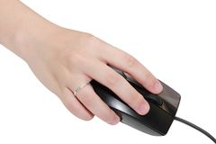 Woman hand click the mouse Royalty Free Stock Photography