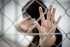 Woman hand close her face and another hand sign for stop abusing stock photography