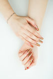 Woman hand close-up with beautiful manicure on white background Royalty Free Stock Photo