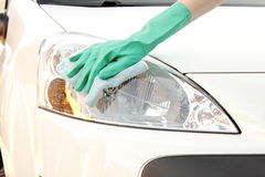 Woman hand with cloth cleaning car Stock Photography
