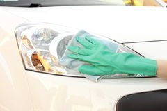 Woman hand with cloth cleaning car Royalty Free Stock Photos