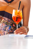 Woman hand with cocktail at beach bar Royalty Free Stock Photography