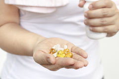 Woman hand with Cod liver oil and supplements Royalty Free Stock Photo