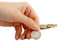 Woman hand with coin. Royalty Free Stock Images