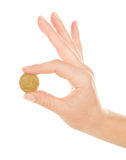Woman hand with coin Royalty Free Stock Images