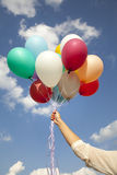 Woman hand with colorful balloons Royalty Free Stock Photo