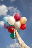 Woman hand with colorful balloons Royalty Free Stock Photos