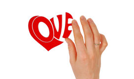 Woman hand composing. Word Love Royalty Free Stock Images