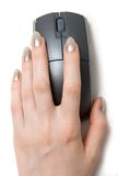 Woman hand on computer mouse.  Royalty Free Stock Images