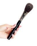 Woman hand with a cosmetic brush Royalty Free Stock Photos