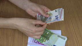 Woman hand count bribe money cash euro banknotes in envelope. 4K