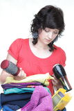 Woman hand crammed full of clothes and shoulder bag isolated Royalty Free Stock Photography