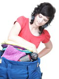 Woman hand crammed full of clothes and shoulder bag isolated Royalty Free Stock Photos