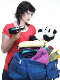 Woman hand crammed full of clothes and shoulder bag isolated Stock Image