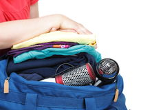 Woman hand crammed full of clothes and shoulder bag isolated Royalty Free Stock Photo