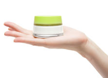 Woman hand with cream pot Royalty Free Stock Image