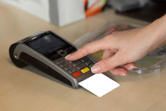 Woman hand with credit card swipe through terminal for sale in restaurant.  stock photos