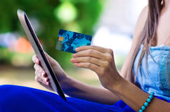 Woman hand credit card and tablet Royalty Free Stock Image