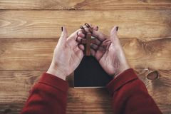 Woman hand cross with book royalty free stock photo