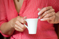Woman hand with cup of coffee Stock Photo