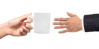 Woman hand with cup of coffee and man hand isolated on white Stock Images