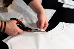 Woman hand cutting fabric Royalty Free Stock Photography