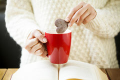 Woman Hand Dipping Cookie in Tea Stock Photos