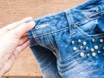 Woman hand DIY Short jean Royalty Free Stock Image