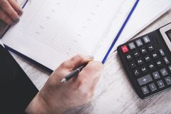 Woman hand documents with calculator stock photos