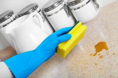 Cleaning dinner table. Woman hand doing chores in the kitchen at home , cleaning dinner table Stock Photo