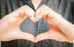 Woman hand doing Heart shape. stock photos