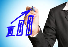 Woman hand drawing a chart Stock Image