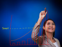 Woman hand drawing a growth graph Stock Image