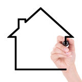 Woman hand drawing house with marker isolated on white Stock Images