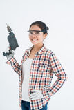 Woman with a hand drill Stock Images