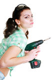 Woman with hand drill Royalty Free Stock Photography