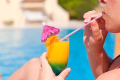 Woman hand drinking cocktail Stock Image