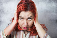 Woman with hand on ears Royalty Free Stock Photo