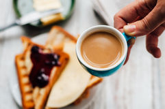 Woman hand eating toast for breakfast Royalty Free Stock Photo