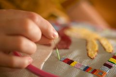 Woman hand embroiders. With a needle and a thread Stock Images