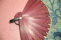 Woman hand fan wooden red color close up royalty free stock photo