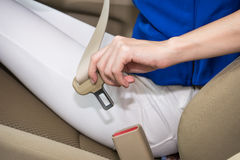 Woman hand fastening a seat belt in the car 1 Royalty Free Stock Images