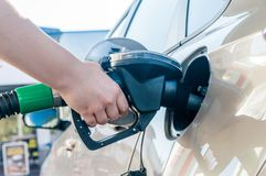 Woman hand filling gasoline car in petrol station.  stock photos