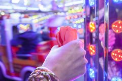 Woman hand with a fistfull of chips for fair ground ride childre Royalty Free Stock Photography