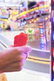 Woman hand with a fistfull of chips for fair ground ride childre Stock Photos